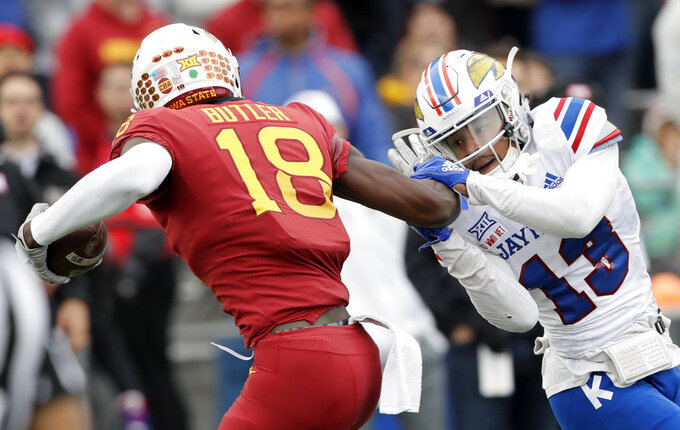 Iowa State wide receiver Hakeem Butler (18) gets away from Kansas cornerback Hasan Defense (13) while scoring a touchdown during the first half of an NCAA college football game in Lawrence, Kan., Saturday, Nov. 3, 2018. (AP Photo/Orlin Wagner)