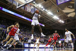 Washington forward Isaiah Stewart grabs a rebound during the first half of the team's NCAA college basketball game against Arizona, Thursday, Jan. 30, 2020, in Seattle. (AP Photo/Ted S. Warren)