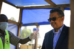 Director-General of the World Health Organization (WHO), Tedros Adhanom Ghebreyesus, right, has his temperature taken as he arrives at Ruhenda airport in Butembo, to visit operations aimed at preventing the spread of Ebola and treating its victims, in eastern Congo Saturday, June 15, 2019. The World Health Organization on Friday said the Ebola outbreak is an