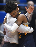 Murray State's Ja Morant (12) embraces Murray State's head coach Matt McMahon during the second half of a second round men's college basketball game against Florida State in the NCAA tournament, Saturday, March 23, 2019, in Hartford, Conn. (AP Photo/Jessica Hill)