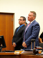 Former Ohio State diving club coach William Bohonyi, left, stands in court with defense attorney Brad Koffel during sentencing on Monday, Aug. 12, 2019, in Columbus, Ohio. Bohonyi was accused of having sex with a teenage diver he coached and was sentenced to four years in prison after pleading guilty to sexual battery. (AP Photo/Kantele Franko)