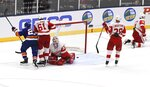 Detroit Red Wings goaltender Jimmy Howard (35) and Jacob de la Rose (61), Gustav Lindstrom (28) and Filip Zadina (11) react after New York Islanders' Anders Lee (27) scored an overtime goal during a preseason NHL hockey game, Monday, Sept. 23, 2019, in Uniondale, N.Y. (AP Photo/Kathleen Malone-Van Dyke)
