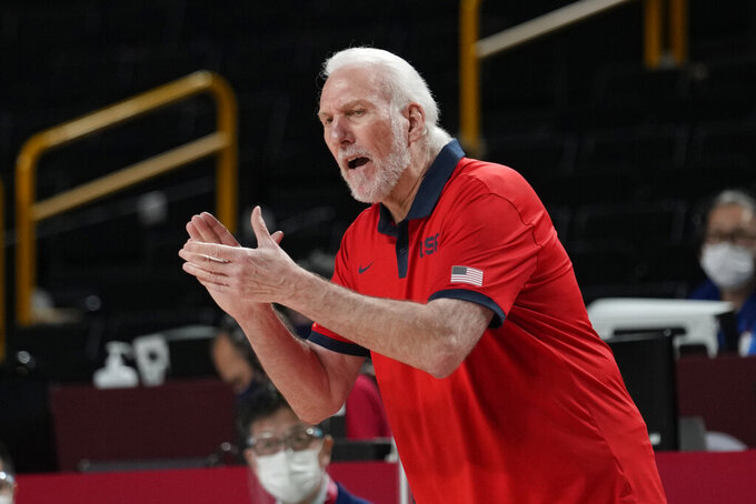 United States of America coach Gregg Popovich talks to his team during a men's basketball preliminary round game against the Czech Republic at the 2020 Summer Olympics, Saturday, July 31, 2021, in Saitama, Japan. (AP Photo/Eric Gay)