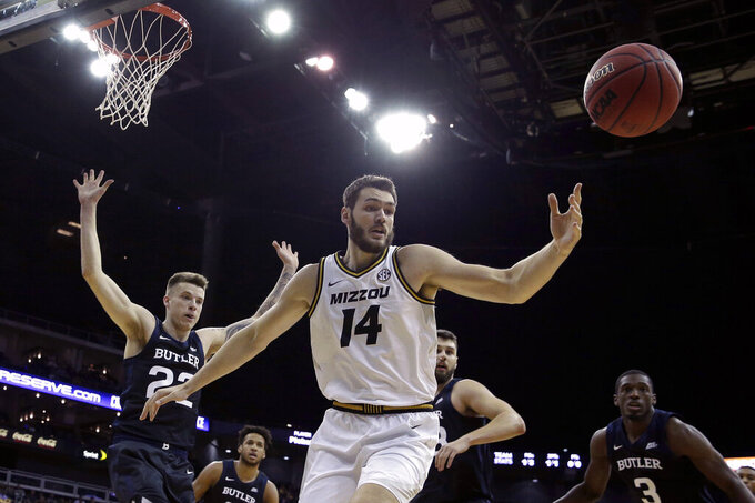 Missouri forward Reed Nikko (14) chases a rebound during the first half of an NCAA college basketball game against Butler, Monday, Nov. 25, 2019, in Kansas City, Mo. (AP Photo/Charlie Riedel)