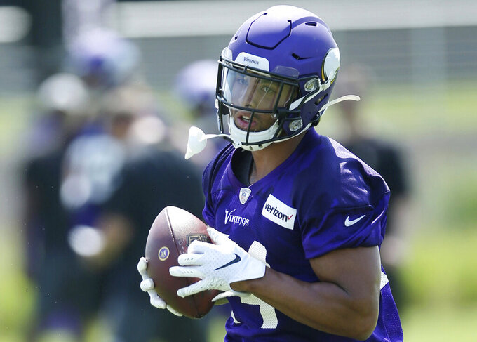 FILE - In this July 23, 2019, file photo, Minnesota Vikings tight end Irv Smith Jr. takes part in an NFL football team training camp in Eagan, Minn. The Vikings have thrust their second-round draft pick into their tight end-heavy offense, carefully evaluating Irv Smith Jr. in training camp to see what he'll be capable of handling during a rookie season that always comes with a steep learning curve.(AP Photo/Jim Mone, File)