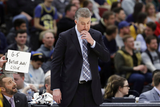 Purdue head coach Matt Painter right looks down during the second half of an NCAA college basketball game against Minnesota in the quarterfinals of the Big Ten Conference tournament, Friday, March 15, 2019, in Chicago. Minnesota won 75-73. (AP Photo/Nam Y. Huh)