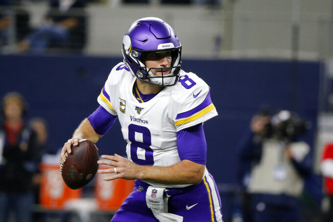 Minnesota Vikings quarterback Kirk Cousins (8) scrambles out of the pocket before throwing a pass during the first half of the team's NFL football game against the Dallas Cowboys in Arlington, Texas, Sunday, Nov. 10, 2019. (AP Photo/Michael Ainsworth)