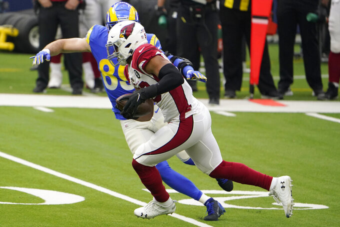 Arizona Cardinals middle linebacker Jordan Hicks, foreground, runs after intercepting a pass in front of Los Angeles Rams tight end Tyler Higbee during the first half of an NFL football game in Inglewood, Calif., Sunday, Jan. 3, 2021. (AP Photo/Jae C. Hong)