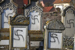 Vandalized tombs are pictured in the Jewish cemetery of Westhoffen, west of the city of Strasbourg, eastern France, are pictured Wednesday, Dec. 4, 2019. Regional authorities in eastern France say vandals have scrawled anti-Semitic inscriptions, including swastikas spray-painted in black, on 107 tombs in a Jewish cemetery. (AP Photo/Jean-Francois Badias)