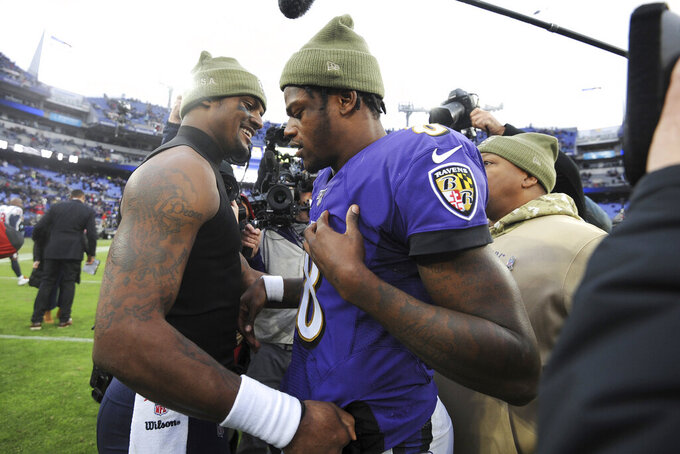Houston Texans quarterback Deshaun Watson, left, talks with Baltimore Ravens quarterback Lamar Jackson after an NFL football game, Sunday, Nov. 17, 2019, in Baltimore. The Ravens won 41-7. (AP Photo/Gail Burton)