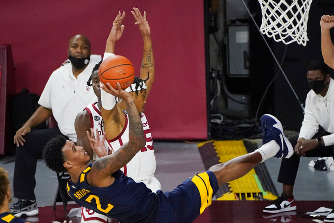 West Virginia forward Jalen Bridges (2) shoots off-balanced after being fouled by Oklahoma guard Alondes Williams, rear, in the second half of an NCAA college basketball game Saturday, Jan. 2, 2021, in Norman, Okla. (AP Photo/Sue Ogrocki)