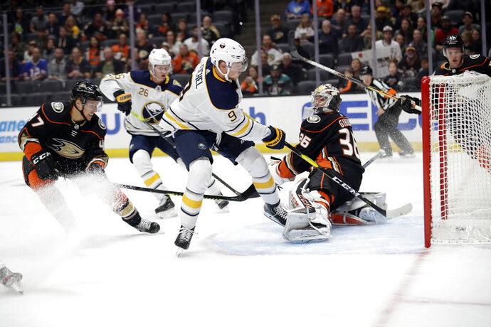 Buffalo Sabres' Jack Eichel (9) scores past Anaheim Ducks goaltender John Gibson, right, during the first period of an NHL hockey game Wednesday, Oct. 16, 2019, in Anaheim, Calif. (AP Photo/Marcio Jose Sanchez)