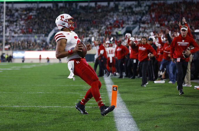 Nebraska quarterback Adrian Martinez runs in for a touchdown against Michigan State during the fourth quarter of an NCAA college football game, Saturday, Sept. 25, 2021, in East Lansing, Mich. Michigan State won 23-20 in overtime. (AP Photo/Al Goldis)