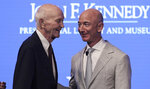 Apollo 11 Astronaut Michael Collins, left, talks with Amazon and Blue Origin founder Jeff Bezos during the JFK Space Summit at the John F. Kennedy Presidential Library in Boston, Wednesday, June 19, 2019. (AP Photo/Charles Krupa)