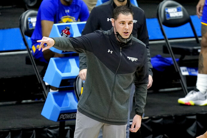 Morehead State head coach Preston Spradlin directs his players during the first half of a college basketball game against West Virginia in the first round of the NCAA tournament at Lucas Oil Stadium Friday, March 19, 2021, in Indianapolis. (AP Photo/Mark Humphrey)
