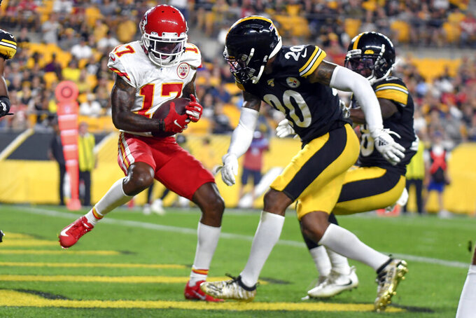 Kansas City Chiefs wide receiver Mecole Hardman (17) makes a touchdown catch in front of Pittsburgh Steelers cornerback Cameron Sutton (20) in the first half of a preseason NFL football game Saturday, Aug. 17, 2019, in Pittsburgh. (AP Photo/Barry Reeger)