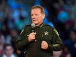 FILE - This Feb. 21, 2018 file photo, shows Broward County Sheriff Scott Israel speaking before a CNN town hall broadcast, at the BB&T Center, in Sunrise, Fla. New Florida Gov. Ron DeSantis suspended Broward County Sheriff Scott Israel on Friday, Jan. 11, 2019 over his handling of February's massacre at Marjory Stoneman Douglas High School.(Michael Laughlin/South Florida Sun-Sentinel via AP, File)