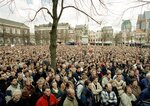 FILE - This is a Tuesday, April 10, 2001, file of thousands of protesters as they demonstrate outside Dutch government buildings at The Hague, Netherlands, as the Upper House of Parliament voted to legalize euthanasia. A Dutch court on Wednesday Sept. 11, 2019 acquitted a doctor in a landmark trial that prosecutors and physicians hope will help clarify how the country's 2002 euthanasia law can be applied to people with severe dementia. (AP Photo/Serge Ligtenberg, File)