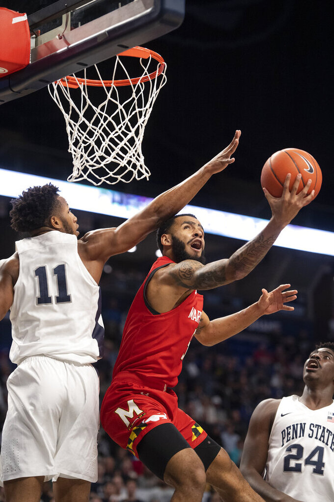 Maryland guard Eric Ayala (5) shoots as Penn State forward Lamar Stevens (11) defends in the first half of an NCAA college basketball game in State College, Pa., on Tuesday, Dec. 10, 2019. (AP Photo/Barry Reeger)