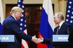 FILE - In this file photo taken on Monday, July 16, 2018, U.S. President Donald Trump, left, shakes hand with Russian President Vladimir Putin at the end of the press conference after their meeting at the Presidential Palace in Helsinki, Finland.  U.S. special counsel Robert Mueller has yet to release his report about Russian meddling in the 2016 U.S. presidential election, but Moscow has already rehearsed its response, dismissing Mueller's investigation as part of the U.S. political infighting. (AP Photo/Alexander Zemlianichenko, File)