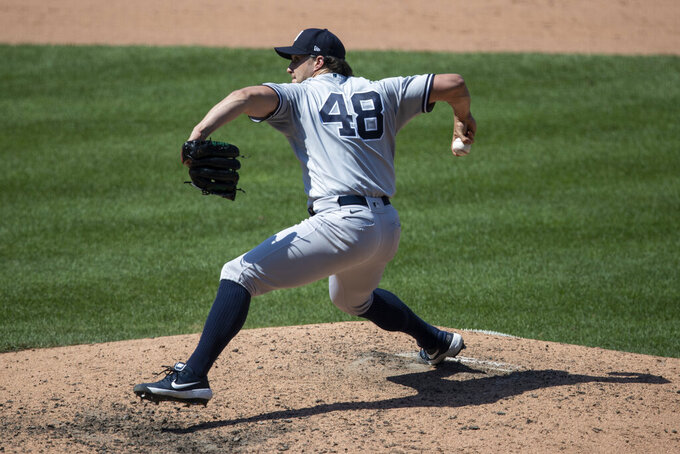 New York Yankees relief pitcher Tommy Kahnle throws during the eighth inning of a baseball game against the Washington Nationals at Nationals Park, Sunday, July 26, 2020, in Washington. (AP Photo/Alex Brandon)