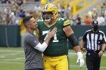 Green Bay Packers head coach Matt LaFleur talks to Josh Myers before a preseason NFL football game Saturday, Aug. 21, 2021, in Green Bay, Wis. (AP Photo/Mike Roemer)
