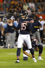 Chicago Bears' Eddy Pineiro (15) reacts after kicking a 32-yard field goal during the first half of the team's NFL preseason football game against the Tennessee Titans, Thursday, Aug. 29, 2019, in Chicago. (AP Photo/Charles Rex Arbogast)