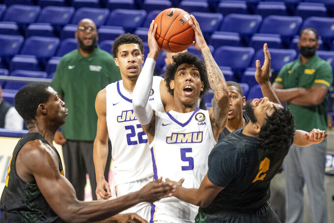 James Madison guard Terrence Edwards (5) knocks over Norfolk State guard Kashaun Hicks (2) as he tries to take a shot during the first half of an NCAA basketball game in Harrisonburg, Va., Friday, Nov. 27, 2020. (Daniel Lin/Daily News-Record via AP)