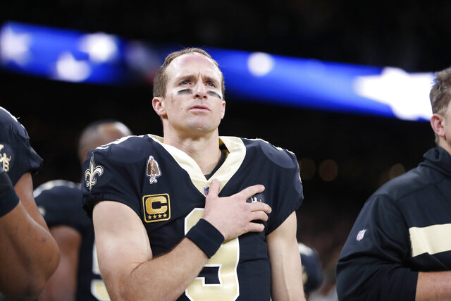 FILE - In this Dec. 23, 2018, file photo, New Orleans Saints quarterback Drew Brees (9) holds his hand to his heart during the national anthem before an NFL football game against the Pittsburgh Steelers in New Orleans. The 41-year-old Brees, who is the NFL's all-time leader in yards passing, completions and touchdowns, is entering his 20th NFL season and 15th with the New Orleans Saints. (AP Photo/Gerald Herbert, File)