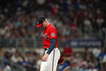 Atlanta Braves relief pitcher Sean Newcomb walks off the pitcher's mound in the fifth inning of a baseball game against the Los Angeles Dodgers, Friday, June 4, 2021, in Atlanta. (AP Photo/Brynn Anderson)