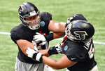 Atlanta Falcons center Alex Mack (51) and guard Chris Lindstrom (63) run a drill during an NFL football training camp practice Thursday, Sept. 3, 2020, in Atlanta. (Hyosub Shin/Atlanta Journal-Constitution via AP)