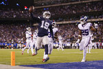 Dallas Cowboys wide receiver Amari Cooper (19) crosses the goal line to score a touchdown against the New York Giants during the fourth quarter of an NFL football game, Tuesday, Nov. 5, 2019, in East Rutherford, N.J. (AP Photo/Adam Hunger)