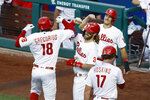 Philadelphia Phillies' Didi Gregorius (18) celebrates with Bryce Harper (3), J.T. Realmuto (10) and Rhys Hoskins (17) after hitting a grand slam off Atlanta Braves pitcher Robbie Erlin during the sceond inning of a baseball game, Monday, Aug. 10, 2020, in Philadelphia. (AP Photo/Matt Slocum)