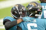 Jacksonville Jaguars wide receiver DJ Chark Jr., left, celebrates with quarterback Jake Luton after Luton threw him a pass for a 73-yard touchdown during the first half of an NFL football game, Sunday, Nov. 8, 2020, in Jacksonville, Fla. (AP Photo/Phelan M. Ebenhack)