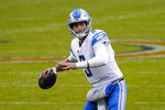 Detroit Lions quarterback Matthew Stafford (9) throws for a touchdown against the Chicago Bears in the second half of an NFL football game in Chicago, Sunday, Dec. 6, 2020. (AP Photo/Nam Y. Huh)