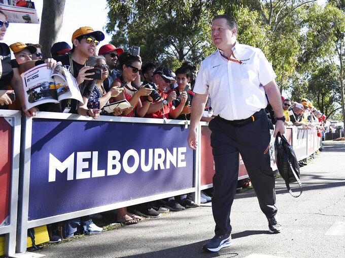 Zak Brown, CEO of McLaren, arrives at the track for the Australian Formula One Grand Prix in Melbourne, Thursday, March 12, 2020. McLaren says it has withdrawn from the season-opening Australian Grand Prix in Melbourne after a team member tested positive for the coronavirus. (AP Photo/Andy Brownbill)