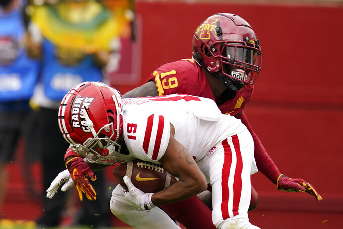 Louisiana-Lafayette cornerback Eric Garror breaks a tackle by Iowa State defensive back Kym-Mani King, rear, during a punt return in the second half of an NCAA college football game, Saturday, Sept. 12, 2020, in Ames, Iowa. Louisiana-Lafayette won 31-14. (AP Photo/Charlie Neibergall)