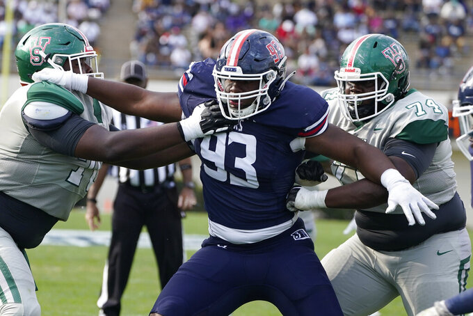Jackson State defense lineman Rasheed Lyles (93) is blocked by double teamed by Mississippi Valley State offensive linemen including Mauriohn Underwood (74) during the second half of an NCAA college football game, Sunday, March 14, 2021, in Jackson, Miss. Jackson State won. (AP Photo/Rogelio V. Solis)