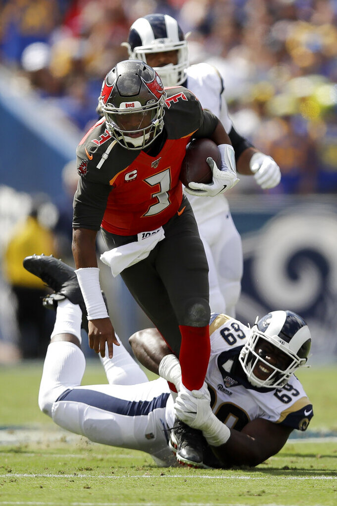 Tampa Bay Buccaneers quarterback Jameis Winston is tackled by Los Angeles Rams defensive tackle Sebastian Joseph-Day during the first of an NFL football game Sunday, Sept. 29, 2019, in Los Angeles. (AP Photo/Marcio Jose Sanchez)
