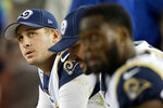 Los Angeles Rams quarterback Jared Goff, left, sits on the bench with teammates during the second half of the team's NFL football game against the San Francisco 49ers in Santa Clara, Calif., Saturday, Dec. 21, 2019. (AP Photo/Tony Avelar)