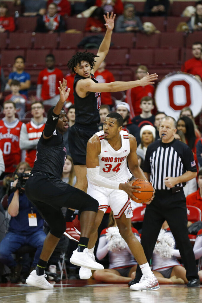 Ohio State's Kaleb Wesson, right, posts up against Rutgers Geo Baker, top, and Shaq Carter during the first half of an NCAA college basketball game Wednesday, Feb. 12, 2020, in Columbus, Ohio. (AP Photo/Jay LaPrete)