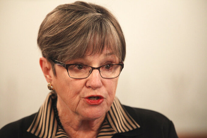 Kansas Gov. Laura Kelly speaks to reporters, Monday, Feb. 22, 2021, during a Statehouse news conference in Topeka, Kan. The Republican-controlled Legislature is pursuing multiple proposals to curb the Democratic governor's power. (AP Photo/John Hanna)