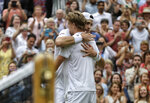 FILE - In this July 13, 2018, file photo, South Africa's Kevin Anderson hugs John Isner of the United States, right, after defeating him in their men's singles semifinals match at the Wimbledon Tennis Championships, in London. The Australian Open and Wimbledon are finally doing what the U.S. Open has done for decades: figuring out a way to end a fifth set before it becomes another 26-24 slog or _ perish the thought _ 70-68. While some fans and others might still like the idea that a match could go on and on and on forever, or seemingly forever, players such as John Isner are thrilled about the change. (AP Photo/Kirsty Wigglesworth, File)