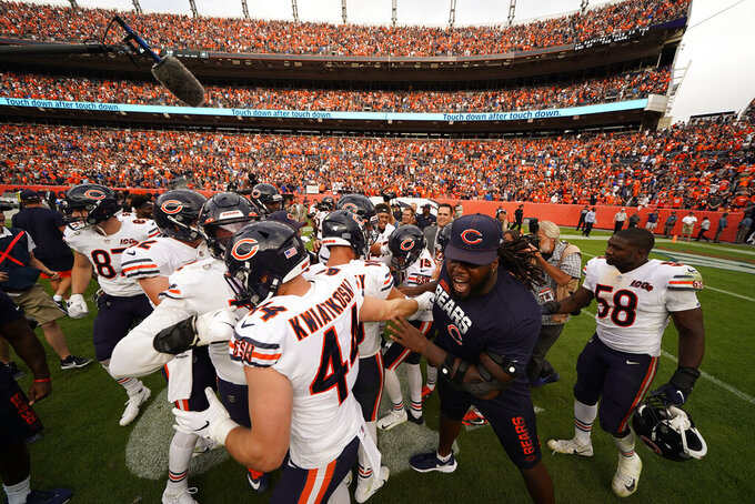 The Chicago Bears celebrate after an NFL football game against the Denver Broncos, Sunday, Sept. 15, 2019, in Denver. The Bears won 16-14. (AP Photo/Jack Dempsey)