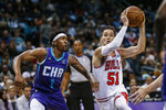 Chicago Bulls guard Ryan Arcidiacono, right, drives next to Charlotte Hornets guard Malik Monk during the first half of an NBA basketball game in Charlotte, N.C., Wednesday, Oct. 23, 2019. (AP Photo/Nell Redmond)