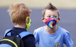 Our Lady of Lourdes Catholic School first-grade student Blake wears a tie-dye mask on the first day of school Wednesday, Aug. 26, 2020, in De Pere, Wis. (Sarah Kloepping/The Post-Crescent via AP)