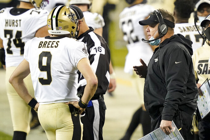 New Orleans Saints head coach Sean Payton, right, talks with quarterback Drew Brees during the second half of an NFL football game against the Carolina Panthers Sunday, Jan. 3, 2021, in Charlotte, N.C. (AP Photo/Gerry Broome)