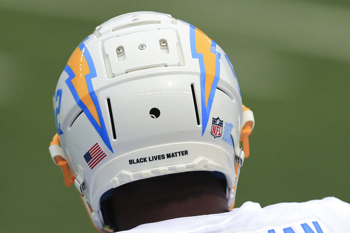 Los Angeles Chargers' Denzel Perryman has a Black Live Matter logo on the back of his helmet before an NFL football game between the Cincinnati Bengals and the Los Angeles Chargers, Sunday, Sept. 13, 2020, in Cincinnati. (AP Photo/Aaron Doster)