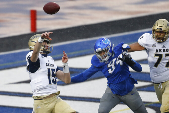 Buffalo defensive end Eric Black (94) pressures Akron quarterback Zach Gibson (15) during the first half of an NCAA college football game in Amherst, N.Y., Saturday Dec. 12, 2020. (AP Photo/Jeffrey T. Barnes)