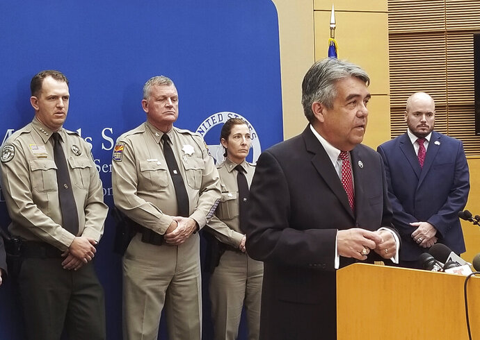 David Gonzales, U.S. Marshal for Arizona, speaks about the capture of husband and wife fugitives on Thursday, Sept. 12, 2019, at the Sandra Day O'Connor Federal Courthouse in Phoenix. Blane and Susan Barksdale, who have been on the run for over two weeks, were taken into custody Wednesday in a rural community about 50 miles (80 kilometers) northeast of Phoenix. (AP Photo/Terry Tang)